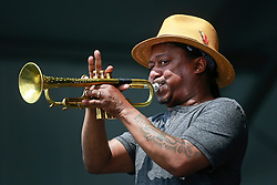 26 April 2014. New Orleans, Louisiana.<br /> Kermit Ruffins plays the New Orleans Jazz and Heritage Festival. <br /> Photo; Charlie Varley/varleypix.com