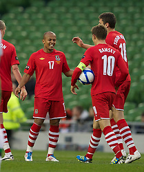 DUBLIN, REPUBLIC OF IRELAND - Friday, May 27, 2011: Wales' Robert Earnshaw celebrates scoring the second goal against Northern Ireland with team-mates during the Carling Nations Cup match at the Aviva Stadium (Lansdowne Road). (Photo by David Rawcliffe/Propaganda)