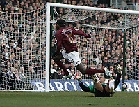 Photo: Lee Earle.<br /> Fulham v Arsenal. The Barclays Premiership. 04/03/2006. Arsenal's Emmanuel Eboue (L) leaves Fulham keeper Tony Warner grounded after scoring their second.