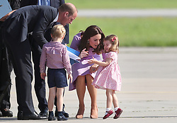 The Duchess of Cambridge talks to Princess Charlotte before the Royal party depart from Hamburg Airport on the last day of their three-day tour of Germany.