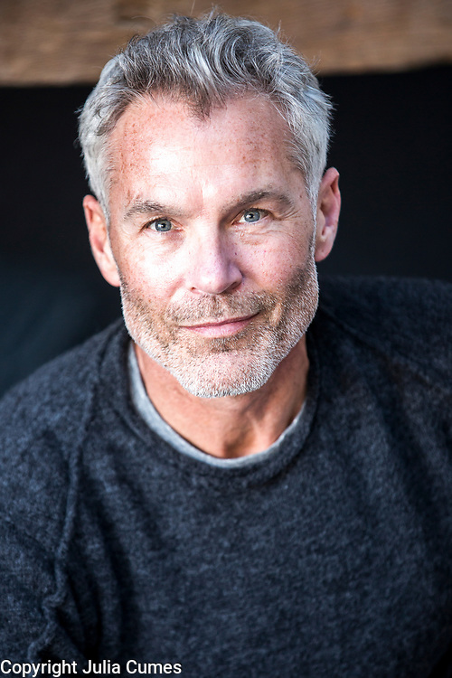 A silver-haired man is photographed.
