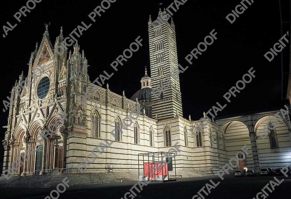 Siena Duomo with its tower illuminated at night side view without people around