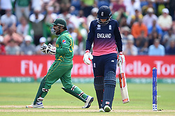 Pakistan's Sarfraz Ahmed (left) celebrates the wicket of England's Joe Root (right) during the ICC Champions Trophy, semi-final match at the Cardiff Wales Stadium.