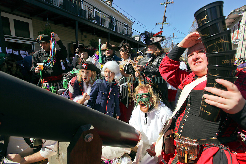 09 February 2016. New Orleans, Louisiana.<br /> Mardi Gras Day. Kids prepare to fire a bead canon in the French Quarter.<br /> Photo©; Charlie Varley/varleypix.com