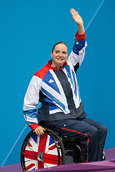 © London News Pictures. 04/09.2012. ParalympicGB swimmer - Heather Frederiksen - wins gold in the Womens S8 100m backstroke in the Aquatic Centre in the Olympic Park, Stratford, London, UK.  Picture credit should read Manu Palomeque/LNP