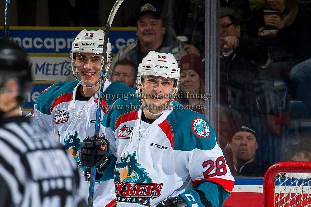 KELOWNA, CANADA - FEBRUARY 6:  Leif Mattson #28 ris all smiles to celebrate the first WHL career goal of Alex Swetlikoff #17 of the Kelowna Rockets against the Spokane Chiefs on February 6, 2019 at Prospera Place in Kelowna, British Columbia, Canada.  (Photo by Marissa Baecker/Shoot the Breeze)
