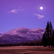 Full moon rises over Lembert Dome in the high country of Yosemite National Park, CA.