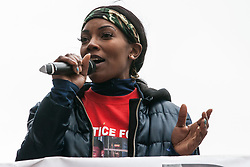 London, UK. 16th March, 2019. Kedisha Brown-Burrell, sister of Kingsley Burrell, who died aged 29 from a cardiac arrest in March 2011 after being restrained whilst detained by West Midlands Police, addresses thousands of people on the March Against Racism demonstration on UN Anti-Racism Day against a background of increasing far-right activism around the world and a terror attack yesterday on two mosques in New Zealand by a far-right extremist which left 49 people dead and another 48 injured.