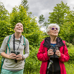 Two women birdwatching in the new Bethel Community Forest in Bethel, Maine.