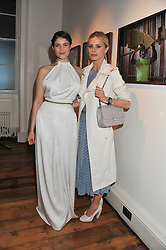 Left to right, GEMMA ARTERTON and LAURA BAILEY at a private view of AMAZON an exhibition of photographs in aid of 'Sky Rainforest Rescue' held in the East Wing Galleries, Somerset House, London on 1st November 2011.