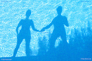 Shadows of a couple in a swimming pool.