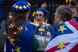 London, UK. 30 January, 2020. Pro-EU activists from SODEM (Stand of Defiance European Movement) stand draped in fairy lights at a party outside Parliament on the eve of Brexit Day on the theme of 'Party like there's no tomorrow'.