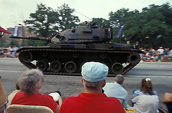 Americana spectators watch army tank in review Stock photo