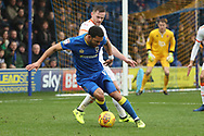 AFC Wimbledon striker Andy Barcham (17) taking on Blackpool's Oliver (Ollie) Turton (20) during the EFL Sky Bet League 1 match between AFC Wimbledon and Blackpool at the Cherry Red Records Stadium, Kingston, England on 20 January 2018. Photo by Matthew Redman.