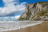 Steep cliffs of Ryten rise above Kvalvika beach, Lofoten Islands, Norway