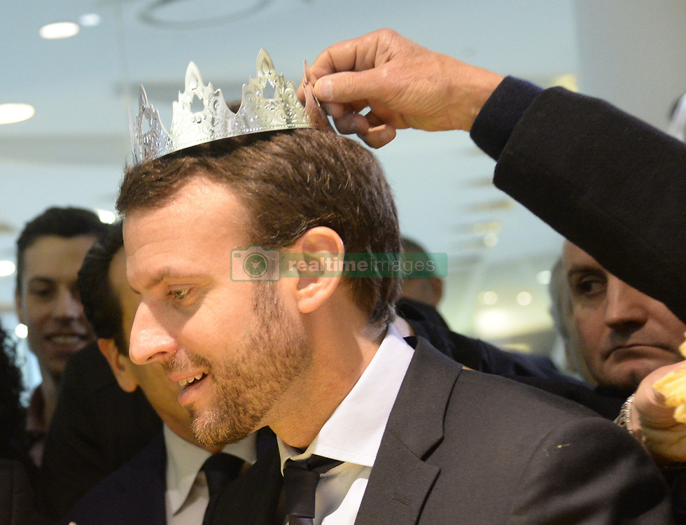 French Minister of the Economy, Industry and the Digital Sector Emmanuel Macron meets with storekeepers and shoppers during his visit to Beaugrenelle shopping mall to mark the official launch of the 2016 winter sales, in Paris, France on January 6, 2016. Photo by Christian Liewig/ABACAPRESS.COM