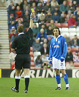 Photo. Andrew Unwin.<br /> Sunderland v Birmingham City, FA Cup Fifth Round, Stadium of Light, Sunderland 14/02/2004.<br /> Birmingham's Christophe Dugarry (r) is shown the yellow card by the referee, Mr G Barber (l).