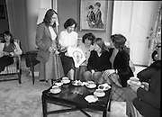 Galway Travellers Visit U.S.Embassy.    (N67)..1981..01.04.1981..04.01.1981..1st April 1981..Elizabeth,the wife of American Ambassador Mr William Shannon,invited a group of Galway travellers to afternoon tea at the residence in Phoenix Park, Dublin...Mrs Shannon and ladies from the Galway travelling community pose for pictures during the afternoon tea. they are seen examining the Claddagh Motif.