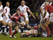 Wales sub scrum half, Gareth Cooper moves the ball out, as Wales go down  to England at in 2006 RBS Six Nations Match, England vs Wales, 43point to 13 at Twickenham on the 04.02.2006.   © Peter Spurrier/Intersport Images - email images@intersport-images mob +44[0]7973 819 551..   [Mandatory Credit, Peter Spurier/ Intersport Images].
