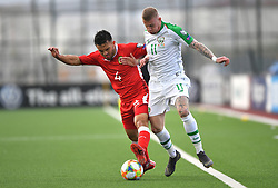 Gibraltar's John Sergeant (left) and Republic of Ireland's James McClean (right) battle for the ball during the UEFA Euro 2020 Qualifying, Group D match at the Victoria Stadium, Gibraltar.