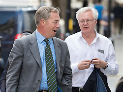 © Licensed to London News Pictures. 01/06/2017. London, UK. Former UKIP leader Nigel Farage is seen in London talking to Brexit Secretary David Davis. He has said that he doubts that the FBI are going to name him as a 'person of interest' in their investigation into Russian involvement in the U.S. election. Photo credit: Peter Macdiarmid/LNP