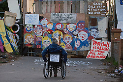 © Licensed to London News Pictures. 19/10/2011. Crays Hill, UK. A woman in a wheelchair at the front entrance to Dale Farm. Residents at Dale Farm, the UK's largest illegal traveller site being evicted today (19/10/2011) following a long dispute with Basildon Council . Travellers and activist had barricaded themselves in to the site in an attempt to prevent their eviction. Photo credit: Ben Cawthra/LNP