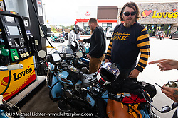 CCC event promoter Jason Sims at a gas stop with his 1946 Harley-Davidson Model U Flathead during the Cross Country Chase motorcycle endurance run from Sault Sainte Marie, MI to Key West, FL. (for vintage bikes from 1930-1948). 287 mile ride of Stage-8 from Tallahassee to Lakeland, FL USA. Friday, September 13, 2019. Photography ©2019 Michael Lichter.`