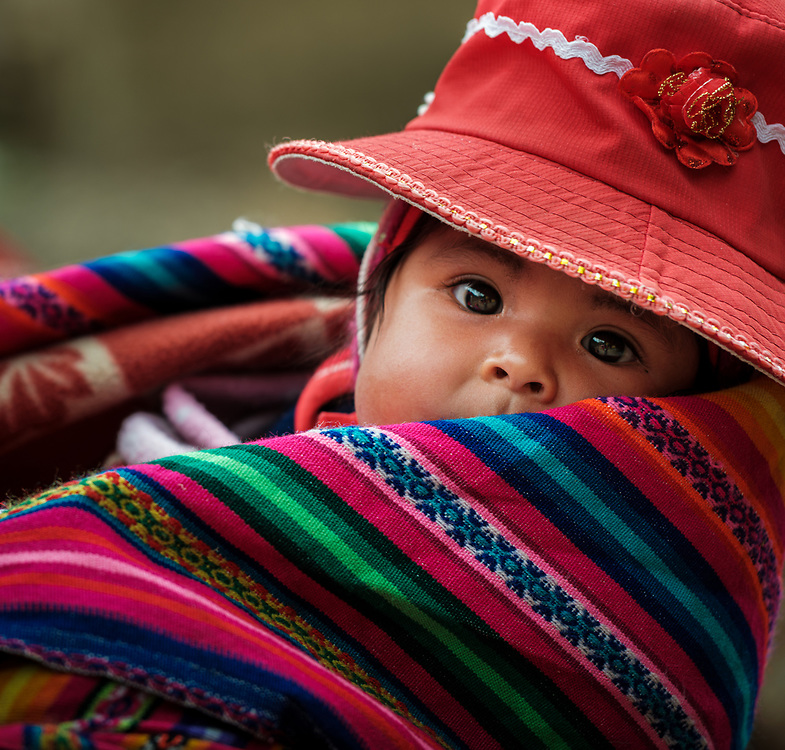 OLLANTAYTAMBO, PERU - CIRCA SEPTEMBER 2019:  Portrait of a baby from the andean community of Willoq close to Ollantaytambo in the Sacred Valley of Peru.