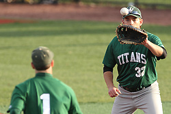 21 April 2015:  Matthew Mardis handles a flip from pitcher Adam Seifert to put out a runner during an NCAA Inter-Division Baseball game between the Illinois Wesleyan Titans and the Illinois State Redbirds in Duffy Bass Field, Normal IL