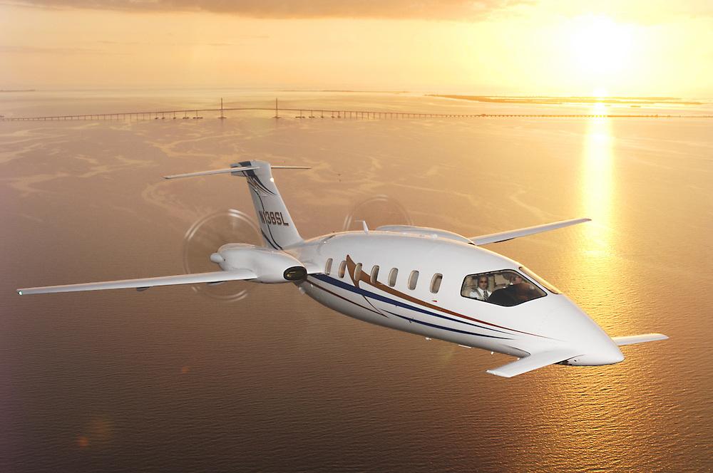 Aviation Piaggio in flight at sunset