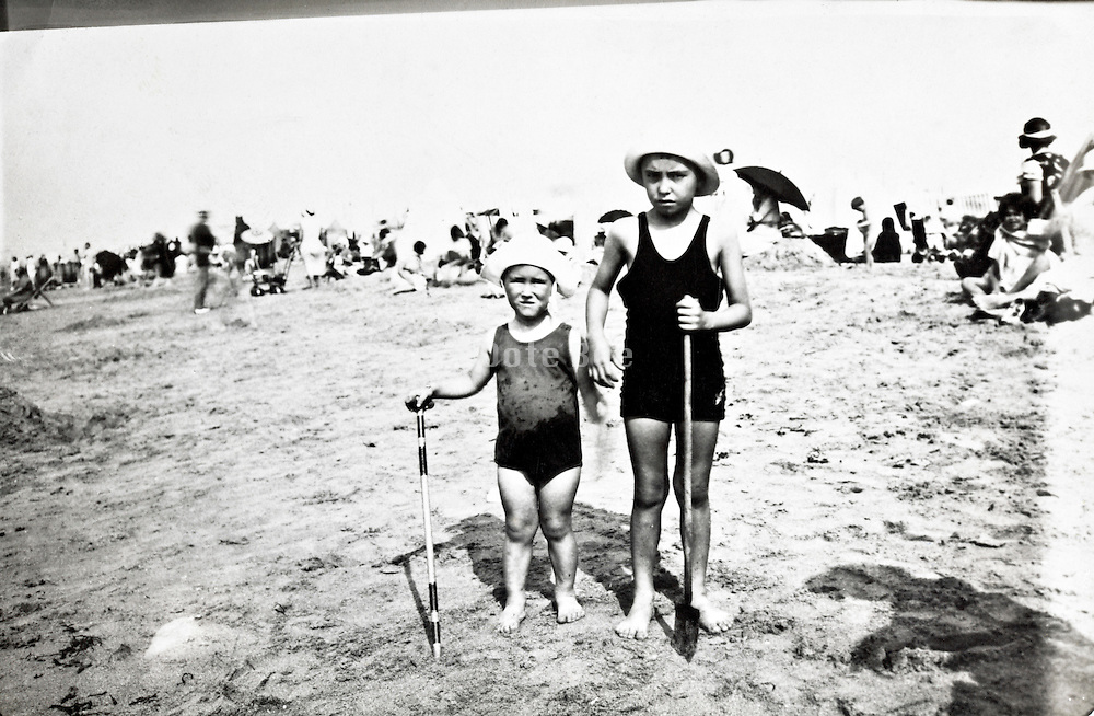 children posing while vacationing on the beach early 1900s
