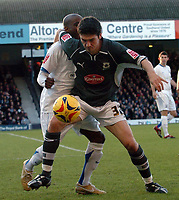 Photo: Ashley Pickering.<br />Southend United v Plymouth Argyle. Coca Cola Championship. 18/11/2006.<br />Plymouth's Bojan Djordjic holds of Southend's Jamal Campbell-Ryce