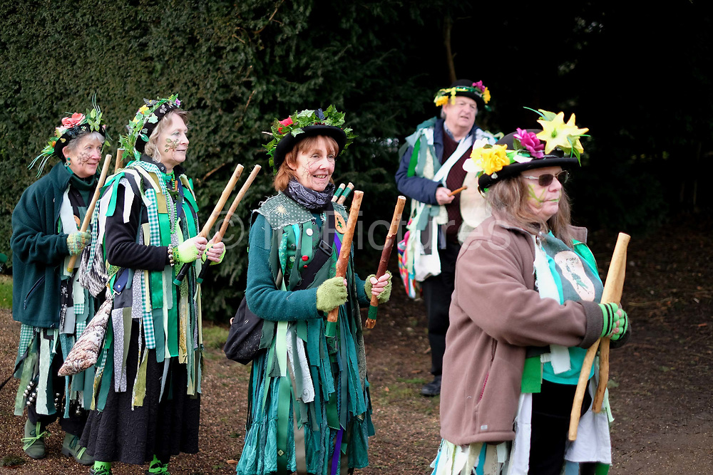 Makara Morris Men dancing a stick dance at an orchard-visiting wassail at Sledmere House, Yorkshire Wolds, UK on 20th January 2018. Wassail is a traditional Pagan winter celebration in cider-producing regions of England, reciting incantations and singing to the trees to promote a good harvest for the coming year. Pieces of toast soaked in cider are hung in the branches to attract robins to the tree as these are said to be the good spirits of the orchard. To ward off evil spirits, villagers scare them away by banging pots and pans and making as much noise as possible
