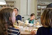 In the Bakers' kitchen, Pickwell Manor, Georgeham, North Devon, UK. From left to right: Richard Elliott, Zac Baker (11). <br /> CREDIT: Vanessa Berberian for The Wall Street Journal<br /> HOUSESHARE