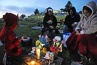 The Carbajal family of Salinas spends time with their departed family members in a touching final celebration of All Soul's Day on Saturday night. Hundreds of congregants came to Queen of Heaven Cemetery in Salinas to attend mass, offer their prayers, and as dusk fell, participate in a candlelight procession.