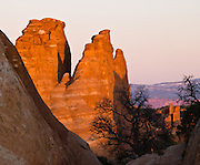 Sandstone pinnacles catch sunset light in Arches National Park, Utah, USA.