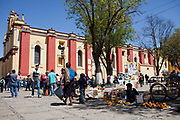People in the Zocalo central square, milling around and selling their wares, street scene, San Cristobal de las Casas, Chiapas, Mexico.