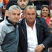 Galatasaray's coach Fatih Terim (R) and Sivasspor's coach Riza Calimbay (L) during their Turkish Super League soccer match Galatasaray between Sivasspor at the AliSamiYen Spor Kompleksi TT Arena at Seyrantepe in Istanbul Turkey on Sunday 05 May 2013. Photo by TURKPIX