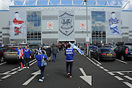 Cardiff city supporters make their way to the stadium before k/o.   NPower championship, Cardiff city v Bolton Wanderers at the Cardiff city Stadium in Cardiff, South Wales on Saturday 27th April 2013. pic by Andrew Orchard,  Andrew Orchard sports photography,