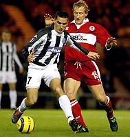 Fotball<br /> Foto: imago/Digitalsport<br /> NORWAY ONLY<br /> <br /> 15.12.2004  <br /> <br /> Nenad Brnovic (Partizan Belgrad, li. / Beograd) am Ball gegen Ray Parlour (Middlesbrough)
