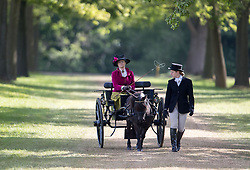Competitors head to the start of Champagne Laurent-Perrier Meet of the British Driving Society at the Royal Windsor Horse Show, which is held in the grounds of Windsor Castle in Berkshire.
