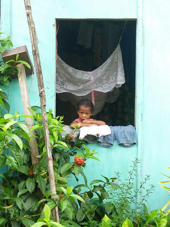 Child in window, Kadavu Koro, Fiji.