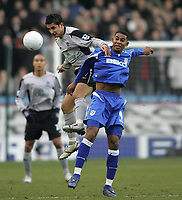 Photo: Lee Earle.<br /> Millwall v Everton. The FA Cup. 07/01/2006. Everton's Tim Cahill (L) battles with Marvin Elliott in the air.