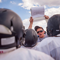 081413       Cable Hoover<br /> <br /> Head Coach Cyle Balok goes over the playbook with his players during Gallup Bengals football practice Wednesday at Gallup High School.