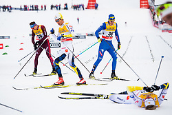 January 6, 2018 - Val Di Fiemme, Italy - MARCUS HELLNER of Sweden collapses after the finish of the men's 15km mass start classic technique cross-country race during Tour de Ski. (Credit Image: © Jon Olav Nesvold/Bildbyran via ZUMA Wire)