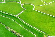 Nederland, Zuid-Holland, Kagerplassen, 09-04-2014; Zwanburgerpolder, polder in de Kager Plassen, in gebruik als grasland voor de veeteelt. De omringende veenplassen zijn ontstaan door het ontginnen van veen. <br /> Peat Lakes, western part of Holland, caused by the reclaiming of peat.<br /> luchtfoto (toeslag op standaard tarieven);<br /> aerial photo (additional fee required);<br /> copyright foto/photo Siebe Swart.