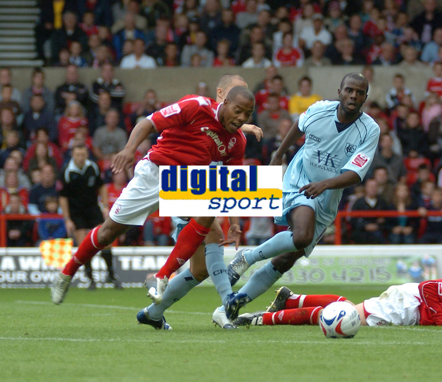 Photo: Ian Hebden.<br /> <br /> Nottingham Forest v Chesterfield. Coca Cola League 1. 02/09/2006.<br /> <br /> Forests Junior Agogo (L) bursts through the Chesterfield defence.