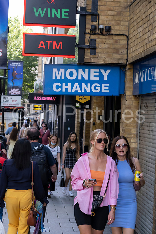 With many people and families staying in the UK for their Summer break during the school holidays, a large number of domestic tourists, who may normally have been travelling abroad, have decended on the capital to see the sights and the money exchange shops have a reason to do more business again on 10th August 2021 in London, United Kingdom. Following the Coronavirus / Covid-19 health scare of the last two years, and with some travel restrictions still in place, more people have chosen a staycation which is a holiday spent in ones home country rather than abroad, or one spent at home and involving day trips to local attractions.