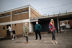 © Licensed to London News Pictures . 18/04/2019. Farnworth , UK . Candidates MAUREEN FLITCROFT (56) , her husband PETER FLITCROFT (55 from Harper Green - leader of Farnworth and Kearsley First ) and JULIE PATTISON (54 from Kearsley), on the abandoned and derelict Market Square in Farnworth Town Centre as the Flitcrofts' grandchildren play behind . Independent political parties , not tied to existing national parties , are competing for council seats in wards across the North West . Photo credit : Joel Goodman/LNP