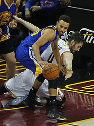 June 9, 2017 - Cleveland, OH, USA - The Golden State Warriors' Stephen Curry, left, and Cleveland Cavaliers forward Kevin Love fight for possession in the third quarter during Game 4 of the NBA Finals at Quicken Loans Arena in Cleveland on Friday, June 9, 2017. The Cavs won, 137-116, trimming their series deficit to 3-1. (Credit Image: © Leah Klafczynski/TNS via ZUMA Wire)